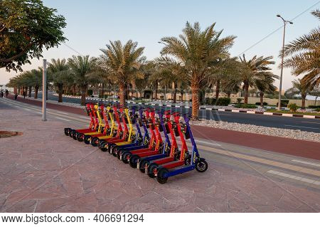 Ras Al Khaimah, United Arab Emirates - February 3, 2020: Rental Electric Scooters By The Running Tra