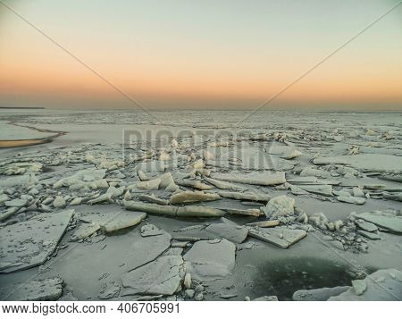 Ice In Winter Sea. North Arctic Winter Sea With Ice Floes On The Sunset. Ice Hummocks On The Arctic