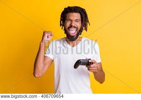 Photo Of Mad Black Guy Hold Joystick Joystick Open Mouth Raise Arm Fist Wear White T-shirt Isolated