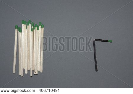 Horizontal Conceptual Subject Photo With A Group Of White Matches Symbolising Human Majorities And A