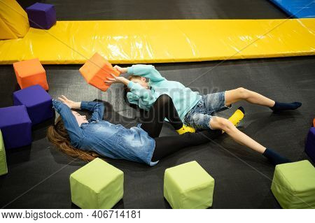 Active Leisure. Children Having Fun On Trampoline In Entertainment Center, Childhood And Sporty Life