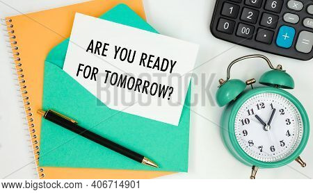 Card On A Postal Envelope With The Text Are You Ready For Tomorrow, Clock, Calculator, Pen.