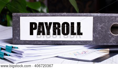 The Word Payroll Is Written On A Gray File Folder Next To Documents. Business Concept