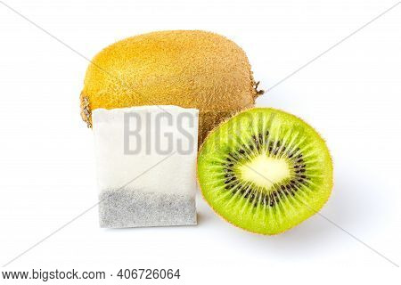 Tea Bag With Kiwi Flavor. Tea Bag And Two Kiwis, One In A Cut Isolated On A White Background. Tea Ba