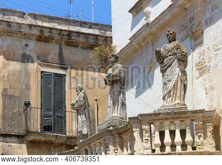 Lecce Cathedral Saint Statues In Italy. Italian Baroque Architecture.