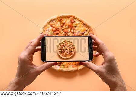 Woman Hands Takes Photography Of Italian Vegan Pizza With Tomato, Mozzarella, Sauce. View From Above