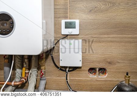 A Modern Gas Boiler For Natural Gas, Installed In A Boiler Room Lined With Ceramic Tiles.