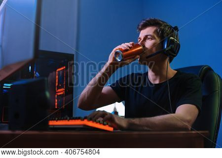 Cyber Sport. Professional Cybersport Player Training Or Playing Online Video Game On His Pc Late At