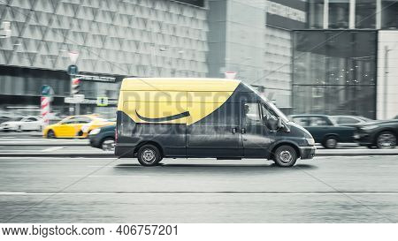 Moscow, Russia - January 29, 2021: Old Gray And Yellow Van Ford Transit T300 On The City Street. Lig