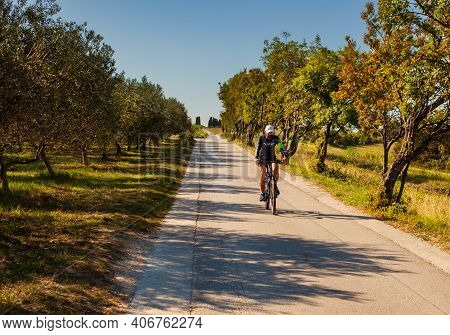 Strunian, Slovenia - September, 19: Mountain Bike Cyclist Riding Countryside Track Next To The Olive
