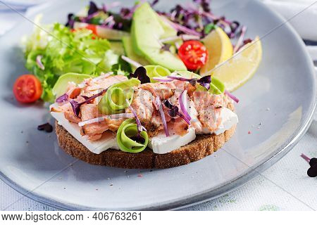 Sandwich With Baked Salmon. Tapas. Sandwich With Salmon, Feta Cheese, Avocado And Microgreens.