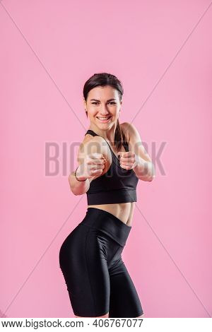 Slim Sportswoman Is Kicking The Air, With Hand And Leg Up . Athletic Girl Doing Boxing Exercises, Ma