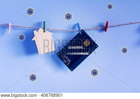Contactless Access Card And Model House Hanging With Plastic Clothespin Twine On Blue Background. Pr