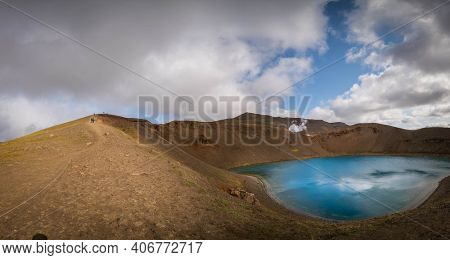 The mouth of a volcano crater filled with water in Iceland. Water Lake in the volcano caldera