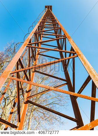 Old Rusty Watch Tower. Old Public Loudspeakers Broadcast On High Tower With Long Distance Tower.