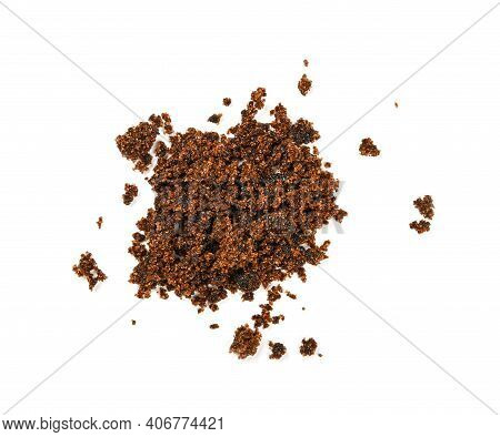 Pinch Of Brown Muscovadocane Sugar Spilled Around Isolated On White Background, Close Up, Elevated T