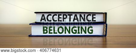 Acceptance And Belonging Symbol. Books With Words 'acceptance And Belonging' On Beautiful Wooden Tab