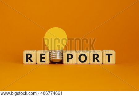 Report Symbol. Wooden Cubes With Word 'report'. Yellow Light Bulb. Beautiful Orange Background. Busi