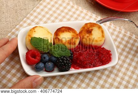 Close Up Eating European Quark Cheese Pancakes Dessert With Fruits, Elevated Top View, Directly Abov