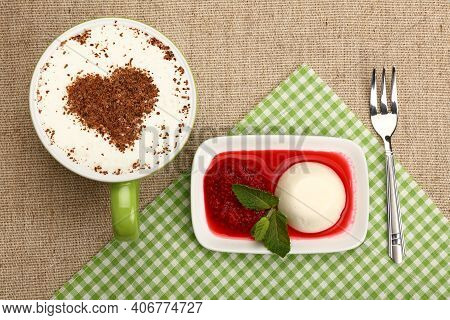 Close Up Serving Panna Cotta Traditional Italian Dessert With Raspberry Jam And Cup Of Cappuccino Co