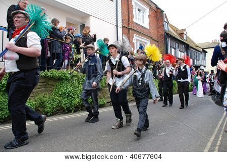 HASTINGS, ENGLAND - MAY 7: People dressed as sweeps parade through the Old Town at the Jack In The Green festival on May 7, 2012 in Hastings, East Sussex. The event marks the May Day public holiday.