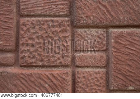 Texture Of Pale Pink Dark Relief Wall With Relief Of Square Stones