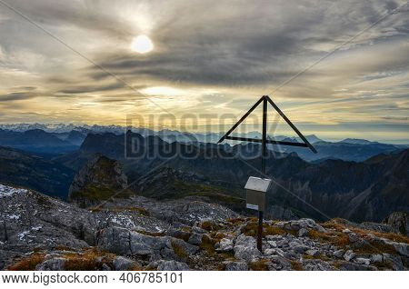 Summit Cross With View Of A Mountain, Photo From The Mountain Peak Mutteristock Glarus. Swiss Mounta