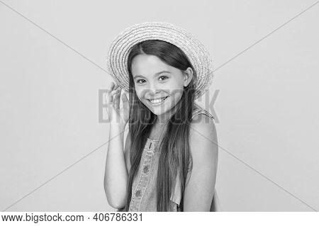 Long-awaited Summer Vacation. Happy Childhood. Cheerful Little Girl Wear Straw Hat. Beach Fashion Fo