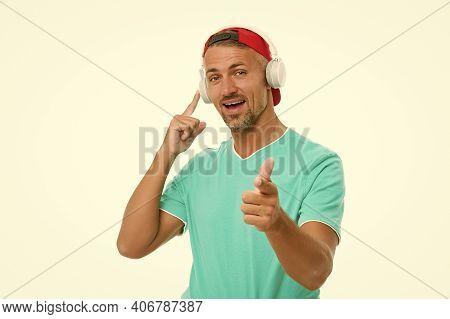 Make Sound Loud. Happy Man Point Finger In Earphones. Unshaven Guy Listen To Sound Track. Enjoying M