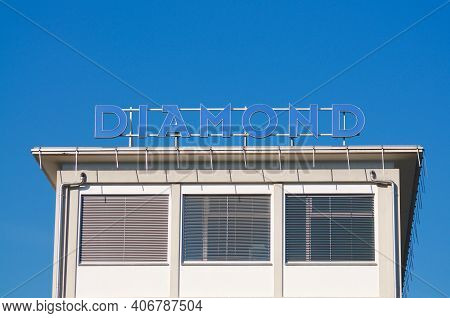Locarno, Ticino, Switzerland - 16th January 2021 : Diamond Sa Company Sign Hanging On The Building I
