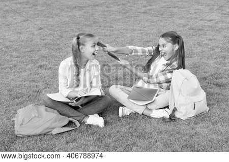Time To Relax. Having Fun On Green Grass. Two Little Kids With Backpack. Small Girl Play And Study O