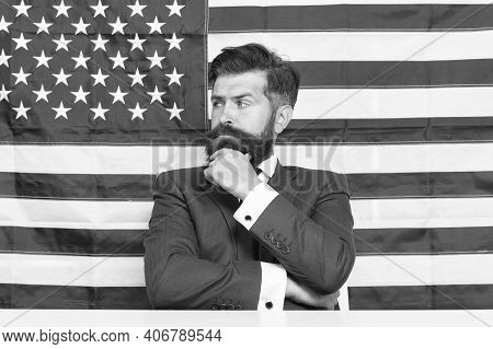 Freedom And Liberty. American Businessman. Serious Businessman On American Flag Background. Business