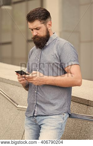 Mobile Networks And Broadband Infrastructure. Bearded Man Text Sms Via Mobile Phone. Sms Mobile Comm