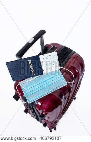 Travel Suitcase, Passport, Boarding Pass And Medical Mask Isolated On White Background. Concept Of T
