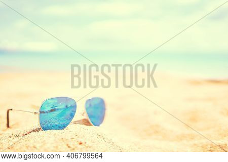 Sunglasses On The Beach. Summer Holidays At The Sea. Vacation On The Ocean. Reflection Of Sandy Beac