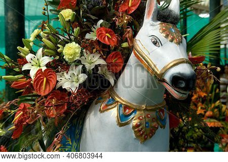 Close-up Of Plaster Image Of White Horse Laden With Flowers At Republic Day Flower Show At Lalbagh I