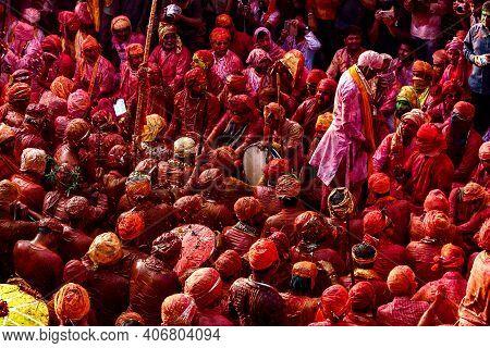 Barsana, Uttar Pradesh, India February 6 2021: People Of Barsana Mathura Playing Holi And Are Covere