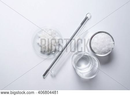 Crystal Clear Liquid In Beaker, Microcrystalline Wax In Glass Container, Flake Salt In Chemical Watc