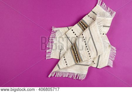 Ethnic Kitchen Napkin With Fringe On A Pink Background. White Linen Napkin With Embroidery. Decorati
