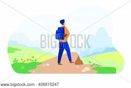 Active Tourist Hiking In Mountain. Man Wearing Backpack, Enjoying Trekking, Looking At Snowcapped Pe