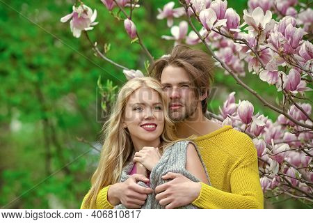 Sensual Couple Hugging In Love On Blossoming Flower, Spring. Love And Romance, Relationship, Happy C