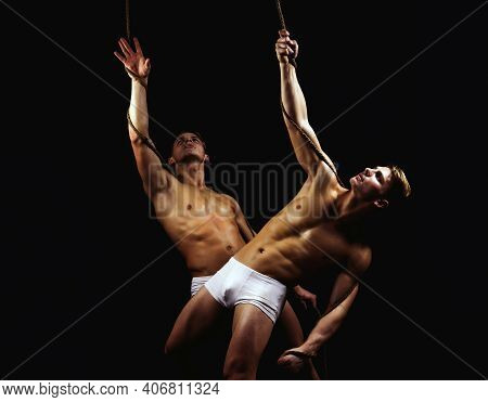 Concept Of Salvation With Two Men. Hands Of Two People At The Time Of Rescue, Helping. Twins Men Wit
