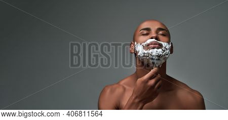 Portrait Of Shirtless Young African American Man Using Steel Razor For Removing Stubble From Neck, P