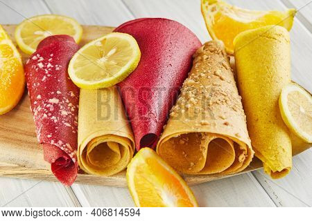 Sweet Pastille Made From Pure Fruits In Rolls With Citrus Fruits. Healthy Sweets - Lollipops, Fruit