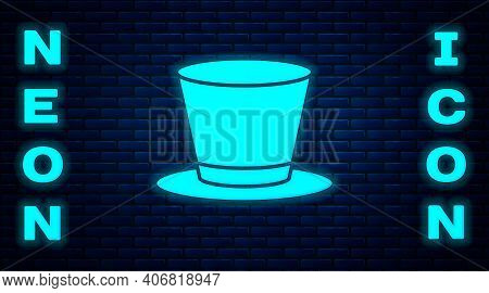Glowing Neon Cylinder Hat Icon Isolated On Brick Wall Background. Vector
