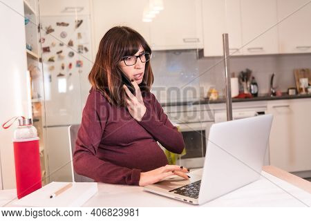 Young Pregnant Woman Teleworking With The Computer From Home Due To The Difficulties Of Working, Mak