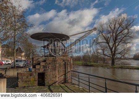 Small Historical Loading Crane On A Pedestal From 1770 At The Nidda Estuary, Frankfurt, Germany