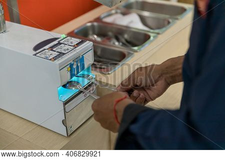 Automatic Sterilizer For Spoon In The Food Court Measures To Prevent Covid-19 Outbreak