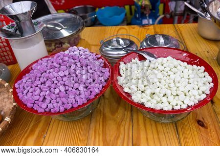 Thai Traditional Dessert Called Bua Loy Is In A Process Before Boiling.  Rice Balls In Sweet Coconut