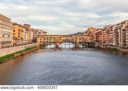 Arno River Leading To The Famous Bridge Ponte Vecchio At The Beautiful Evening In Florence, Italy